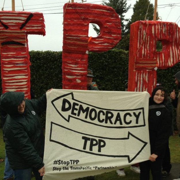Hundreds Gather at Peace Arch to Flush & Smash the TPP!!