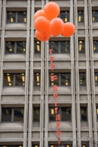 Using gigantic balloons, protesters raised a message outside Senator Murray's and Cantwell's offices.