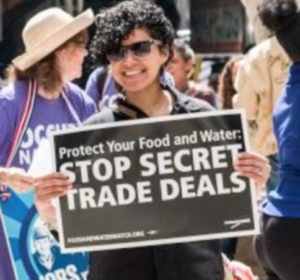 Stop Secret Trade Deals - person with sign